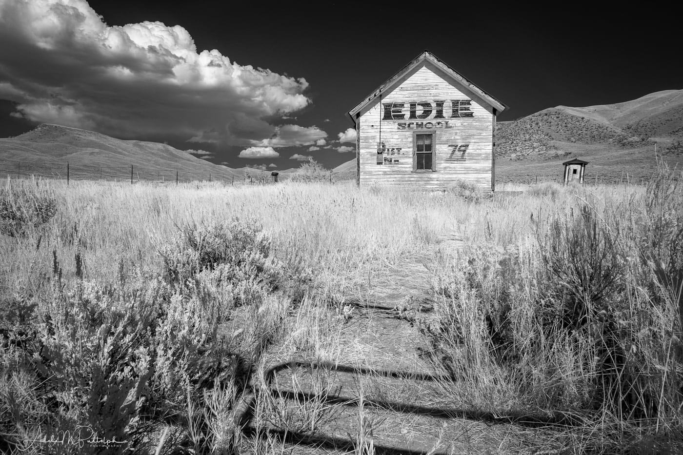 A black and white infrared photograph of Edie School shot on a back road in Idaho.