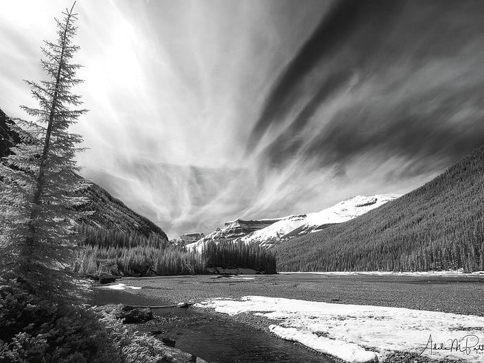 Spectacular clouds above the Athabasca River, Canadian Rockies. Shot in infrared and converted to black and white.