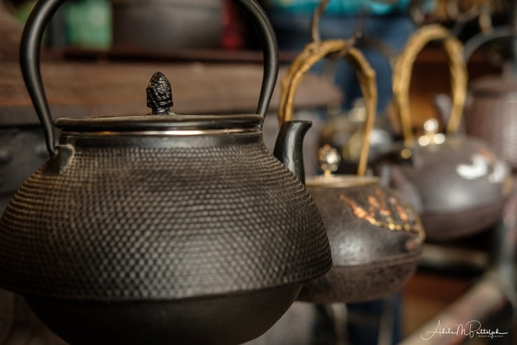 Kettles hanging in a mercantile in Barkerville, British Columbia