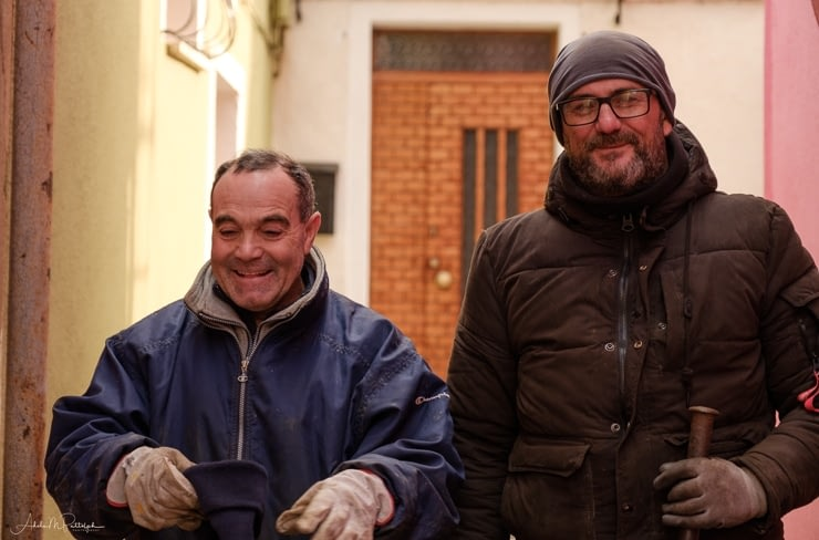 Portrait of a pair of happy street maintenance workers photographed on Burano, Italy