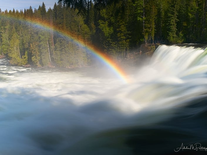 Dawson Falls, located in Wells Gray Provincial Park, British Columbia, Canada with a rainbow.