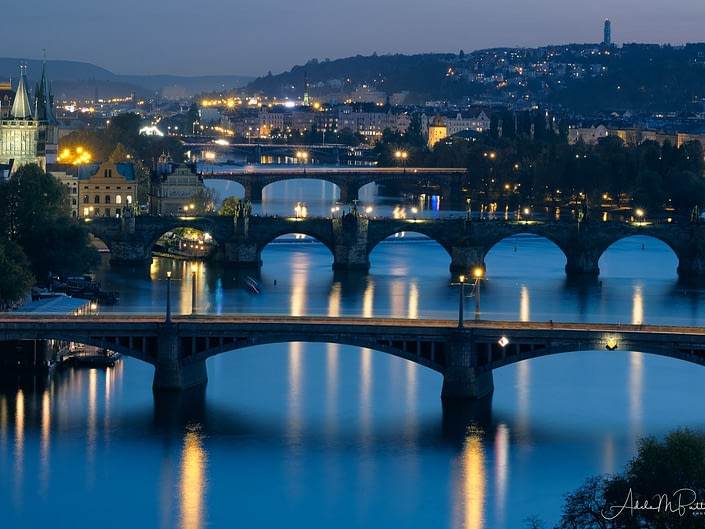Evening photograph of bridges spanning the Vltava River in Prague, Czech Republic