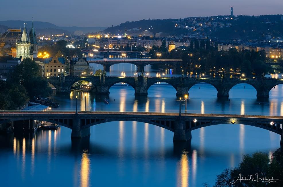 Evening photograph of bridges spanning the Vltava River in Prague, Czech Republic